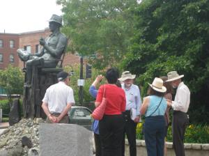 Participants on a 2012 Historic Portland Walking Tour check out the statue of John Ford.
