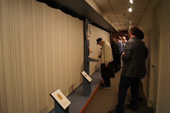 Visitors view the Memorial Wall, which lists more than 9,000 names of Maine soldiers who died during or as a result of service in the Civil War.