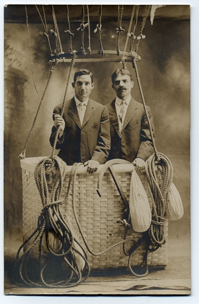 "Anthony Petropulos (left) and Eugene Dessureau (right) in balloon, ""Pittsfield in the Heart of the Berkshires."" June 1909. Anthony Petropulus was residing in Pittsfield, Mass. where he worked for General Electric."