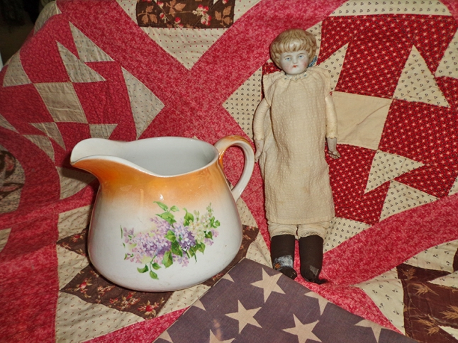 The families' surviving relics were a 1888 wedding quilt sewn, a 1890s bisque doll, the 1908 46-star American flag that once flew at Pine View Farm, and a 1918 china pitcher.