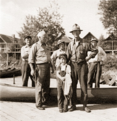 Harris S. Colt, grandson of longtime Parmachenee Club member Harris D. Colt of New York City, poses with the staff of the private hunting-fishing club at Parmachenee Lake.