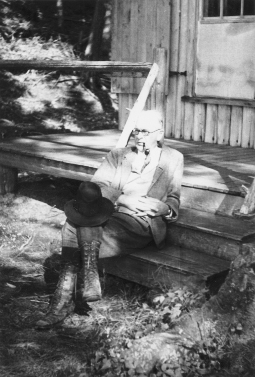 Harris D. Colt, a New York City lawyer, on the steps of a cabin at the Parmachenee Club on Caribou Island on Parmachenee Lake. MMN# 19383